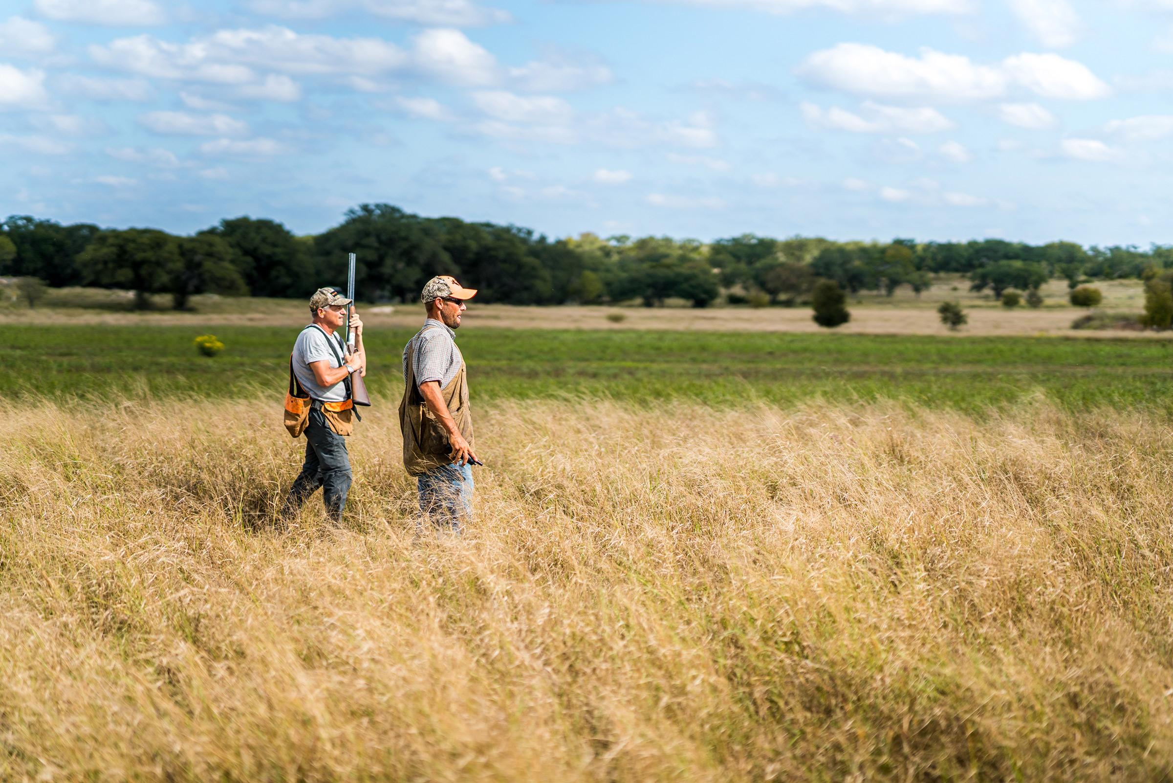 Two hunters in a field